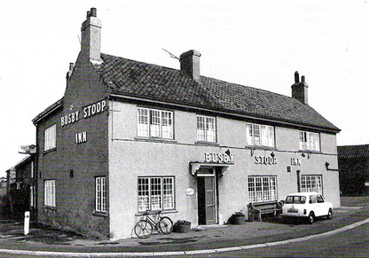 Image of Busby Stoop Inn at Sandhutton crossroads in North Yorkshire, England