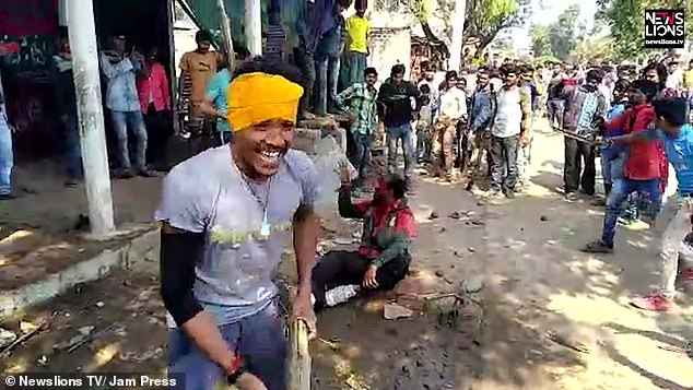 Image of The village mob beating other farmers over rumors of Child lifting