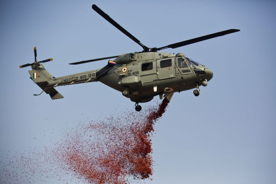 Image of IAF Helicopter spraying flower petals above Rajpath during Republic Day on 26th Jan. 2018