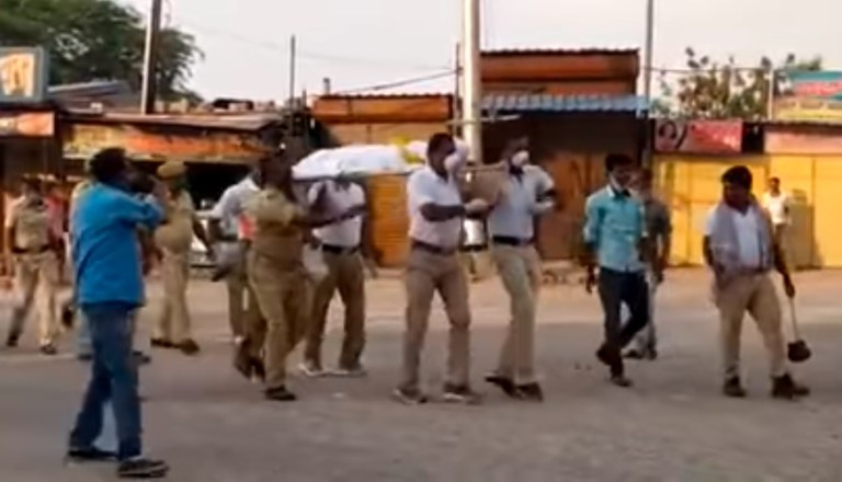 Image about Police Dance Carrying a Dead Body in COVID-19 Pandemic