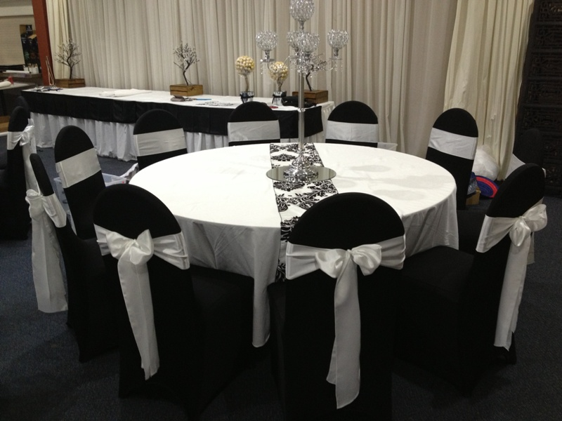 black chair covers to hire paper for weddings cover boys formal wear flower girls plus size gowns and white band tasmania hobart