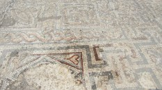 Remaining mosaic tiles on the ground