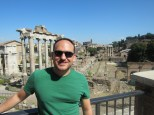 That's the remnants of the Temple of Saturn behind me, and of course the Colosseum way back there