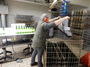 This machine is pretty clever and gets the bottles all at once for each row