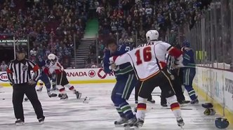 Canucks and Flames Start Game With Line Brawl