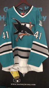 1997 San Jose Sharks.  #41 Mark Smith.  Nike Teal Preseason Jersey.  Size 56.  Nameplate slight cracking with pealing.  Obtained from Team.