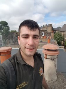 Master chimney sweep Torquay and Devon mr danny hodgson on a roof top
