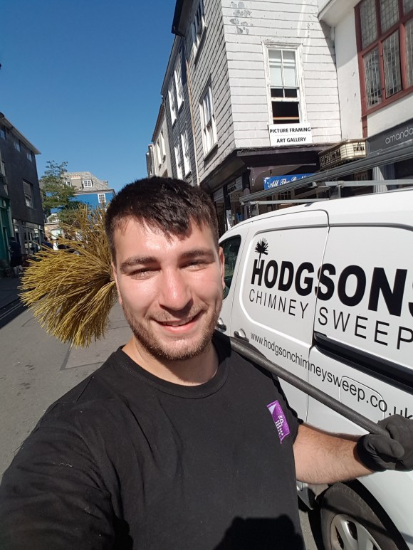 Danny Hodgson Chimney Sweep of Hodgsons Chimney Sweeps, Sweeping on Totnes High Street