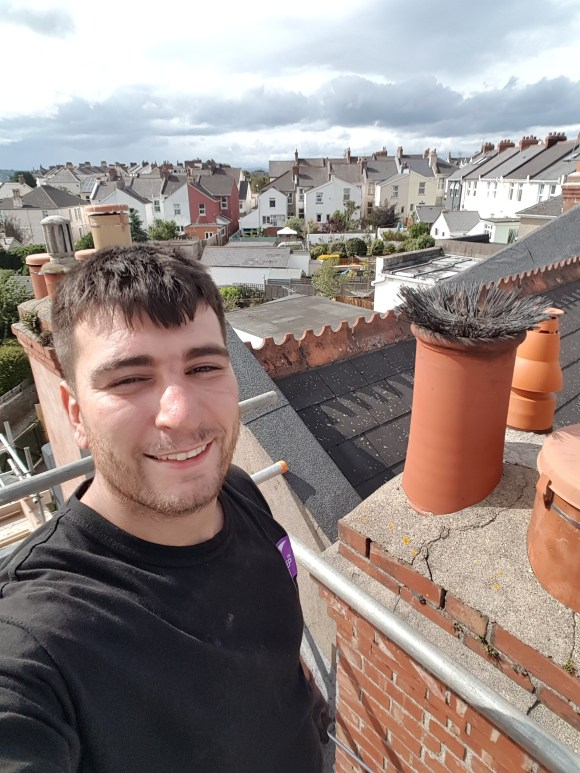 Mr Danny Hodgson Sweep the Chimney prior to a Flue Liner installation via scaffold in Dartmouth as a HETAS Registered Installer