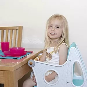 Cheap plastic highchair at the table