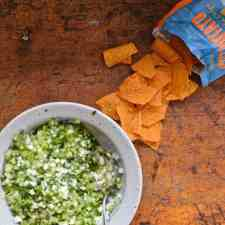This fresh, raw Tomatillo Pico de Gallo is a zesty salsa that captures the essence of tart tomatillos, chiles, and onions. Perfect for chips or tacos. #tomatillo #tomatillosalsa #picodegallo #chipsandsalsa
