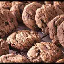 These chocolate chip coffee cookies are made for coffee lovers with ground coffee beans, milk chocolate chips, and vanilla. A kick to your favorite cookie.