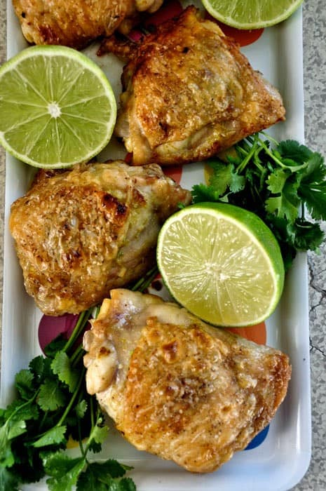 These four-ingredient Simple Roasted Lime Chicken Thighs will be your weeknight dinner savior. So incredibly delicious, you won't believe how easy it is! #chicken #easychicken #chickenthighs #chickenthighsrecipe #roastedchicken