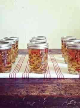 Homemade Apple Hot Pepper Jelly makes the most delicious gifts not to mention it is the perfect balance of sweet and spicy. Try with cheddar pie crackers!