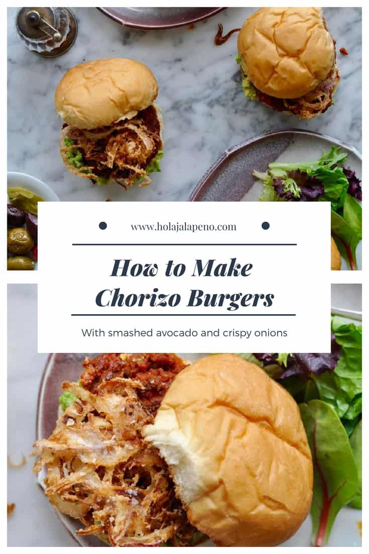 These chorizo burgers are made with Mexican chorizo and ground beef then topped with smashed avocado and a generous pile of crispy fried red onion strings. #burger #chorizo #burgerrecipe #chorizorecipe