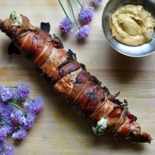 This grilled Cotija Stuffed Pork Tenderloin wrapped in bacon and brushed with mustard is the most surefire way to impress your guests this grilling season. #porktenderloin #grilledporktenderloin #stuffedporktenderloin #baconwrappedpork