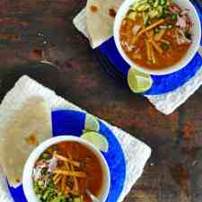 The best recipe for leftover Thanksgiving turkey. This leftover turkey tortilla soup has a spicy chile and tomato broth and lots of toppings. Gluten-free!