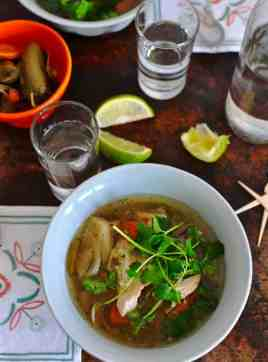 This slow cooker caldo de pollo is a delicious chicken soup recipe that comes together in 15 minutes, flavored with chiles, cilantro, mint, and marjoram. Slow Cooker Mexican Chicken soup recipe. Latin recipes, healthy Latin recipe, Mexican recipe, Mexican chicken soup clado de pollo. #caldodepollo #mexicanchickensoup #healthyMexicanrecipe #healthysouprecipe