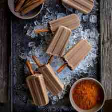 These super simple vegan Mexican chocolate popsicles are rich and creamy with hints of chili and cinnamon and chocolate and take about 10 minutes to make!