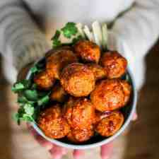 These Honey Chipotle Cocktail Meatballs make a stunningly simple party appetizer with just three ingredients, they are made as fast as they disappear.