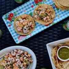 Jump into spring with this shrimp and melon ceviche! Pile this bright and citrusy salad on top of crunchy tostadas for a light meal or an easy appetizer at your next backyard party. #shrimpceviche #healthyLatinrecipe #cevicherecipe