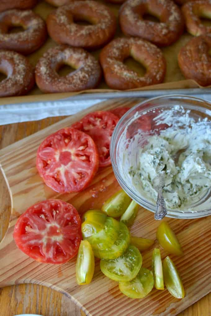 Worm Salt Bagels are just what they sound like: chewy homemade bagels made with worm salt or sal de gusano. Top with poblano chile cream cheese and tomatoes. #bagels #bagelrecipe #saldegusano #wormsalt #tomatorecipe