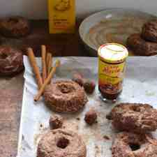 Homemade donuts are an enormous treat and these Mole Membrillo Donuts are extra special made with spiced mole and quince paste, also known as membrillo.The mole paste is decadent in these donuts adding warm spice, chocolate notes, and a hit of chili. These old fashioned cake donuts have a craggy crust, perfect for holding the cinnamon-sugar sprinkle! #donuts #doughnuts #mole #awakenyoursenses #cakedonuts #frieddonuts #oldfashioneddonuts