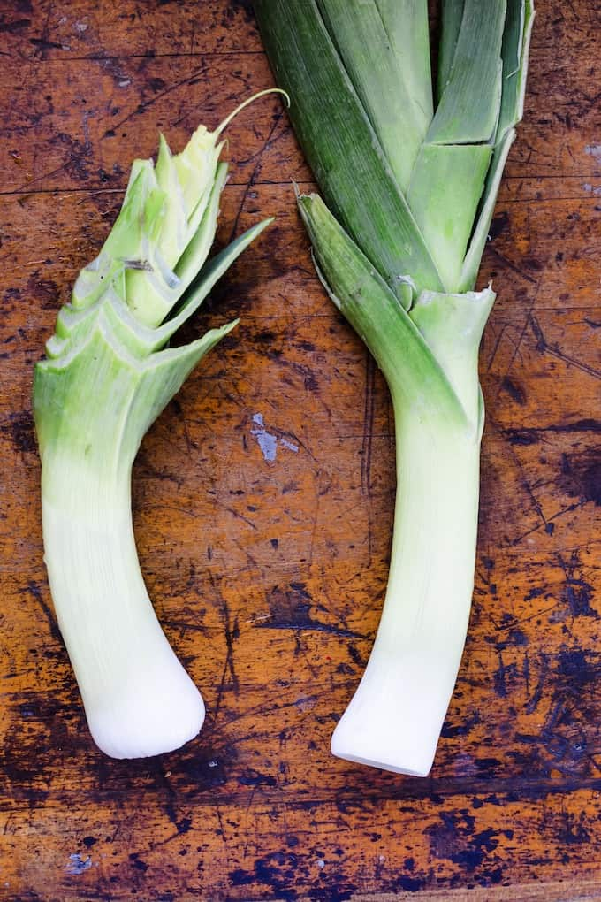 The first step to cleaning leeks is to remove the tough green tops. #leeks #howtocleanleeks #leekrecipes