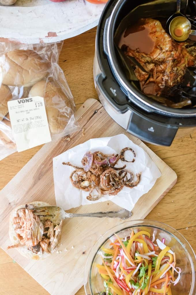 Making Mexican Pulled Pork Sandwiches from pork shoulder cooked in a crock pot, onion straws, and pickled vegetables. #holajalapeno #pulledpork #pulledporksandwiches