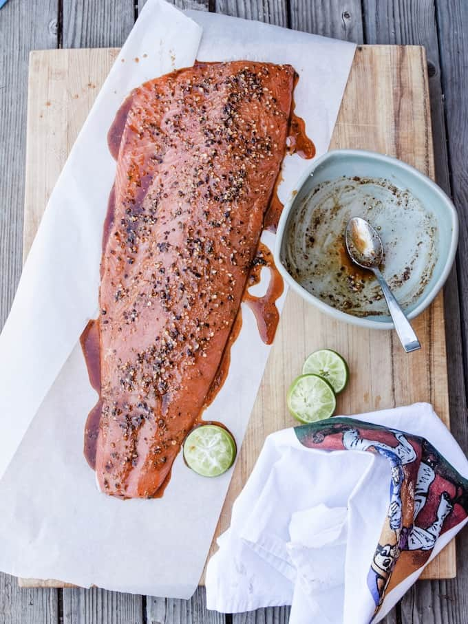 Side of salmon marinated and ready for the grill.