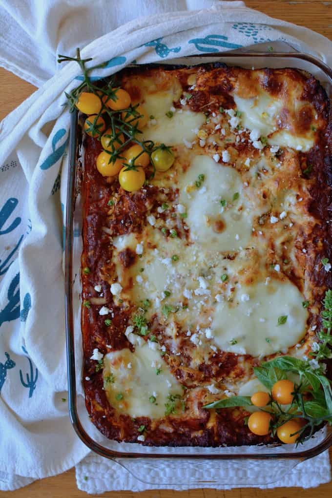 Mexican Lasagna made with chorizo bolognese, three kinds of Mexican cheese, and no-boil noodles is a potluck-lover's dream! #ad #holajalapeno #riolunaorganic #mexicanlasagna
