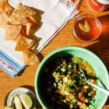 This recipe for Margarita Salsa is simple and easy and can be made in under 10 minutes. It's a little sweet, a bit tart, with a splash of tequila. Perfect for a snack with chips or topping grilled pork chops, chicken, or fish. Vegan and gluten-free! #mexicansalsa #salsarecipe #mangosalsa #tequila