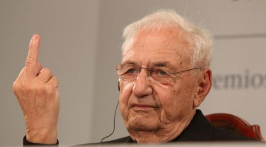 Frank Gehry giving someone the middle finger.