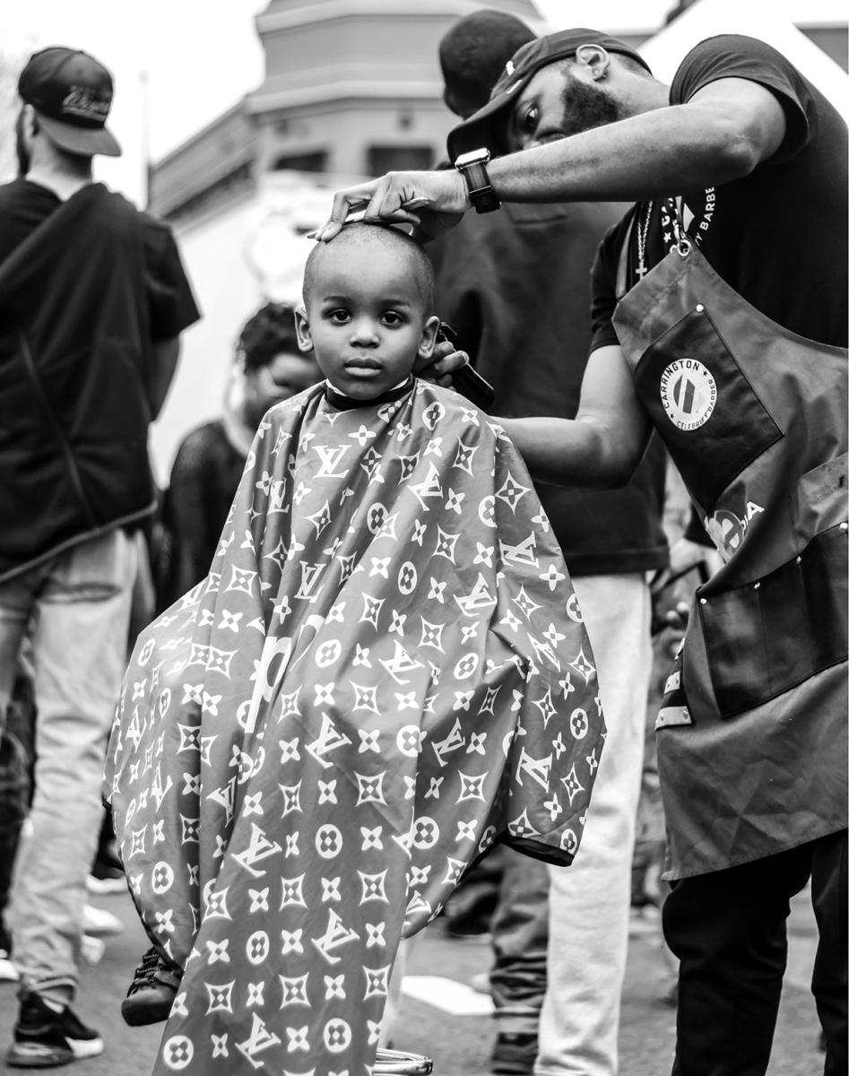 Portrait of kid getting haircut by Dee Dwyer