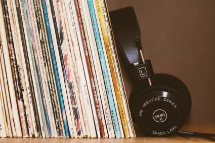 Headphones leaning against vinyl records