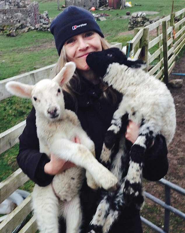 Mhairi Killin with lambs Iona