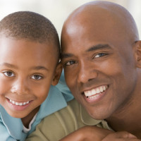 Man and young boy embracing and smiling
