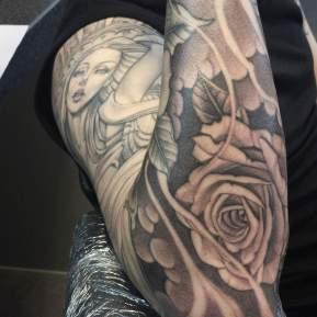 engel fine line single needle black & gray tattoo