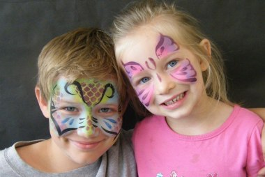 face painting on a boy and girl