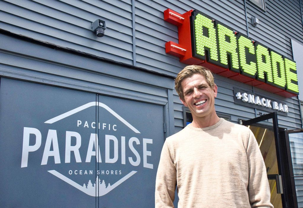 Pacific Paradise Owner James Austin with Exterior Marquee Sign