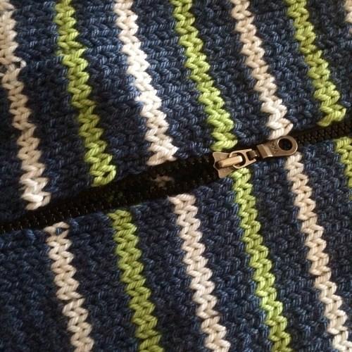 zipper in a hand knit sweater