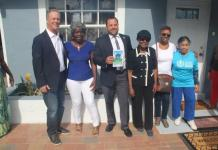 County and city officials at the dedication of Juliet McGriff's renovated home on Fletcher Street.
