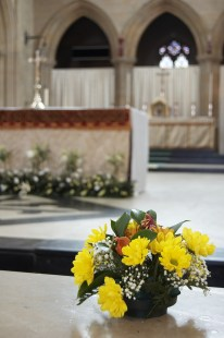 A flower arrangement on the altar rail