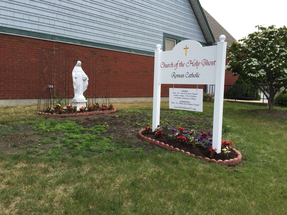 Statue of Our Lady and Holy Ghost sign