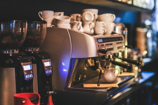Cups on top of coffee machine