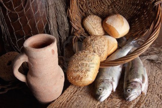 4967720-vintage-still-life-of-an-old-wine-jug-with-bread-loaves-and-fresh-fish1