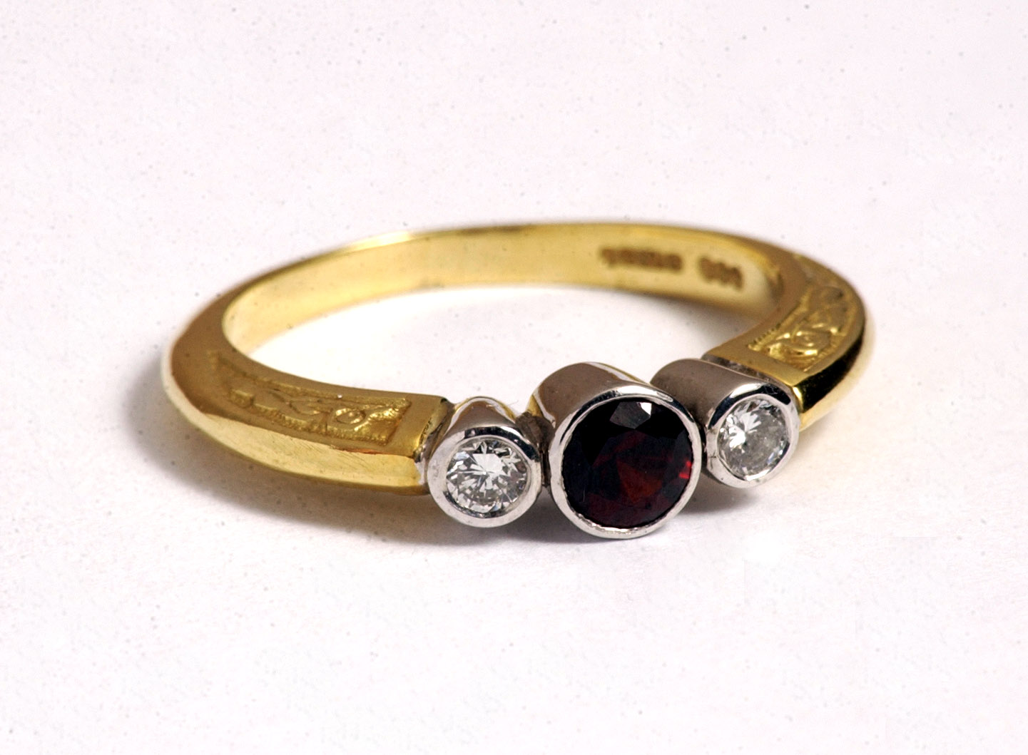 An engagement ring set with a rare Scottish Elie Ruby. PR photography