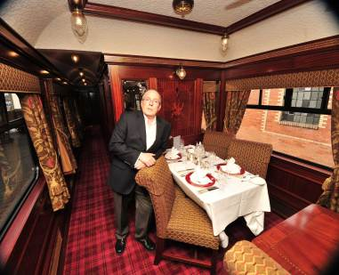 Nigel Woolford on board the rail carriage he painstakingly restored