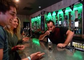Irish funnyman Paddy McCullagh teaching jokes and trickes to staff at Biddy Mulligans
