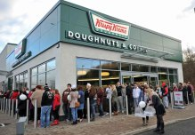 Customers stand in line outside Scotland's only Krispy Kreme outlet